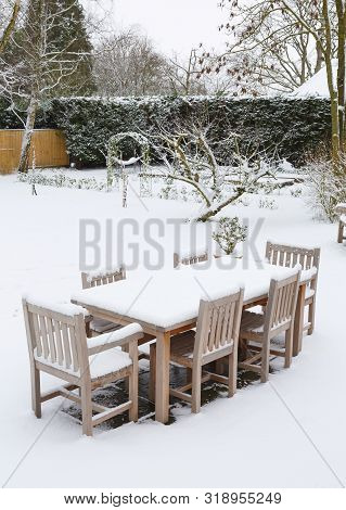 Snow Covered English Garden And Patio Furniture, Uk