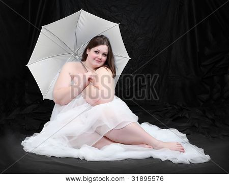 Retro style picture of a overweight woman posing on a black background.