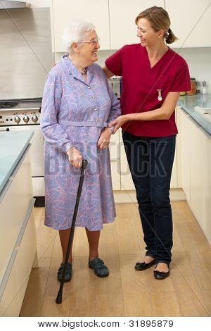Senior woman and carer in kitchen