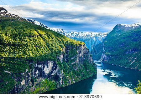 poster of Tourism vacation and travel. Beautiful view over magical Geirangerfjorden from Flydalsjuvet viewpoint, Norway Scandinavia.