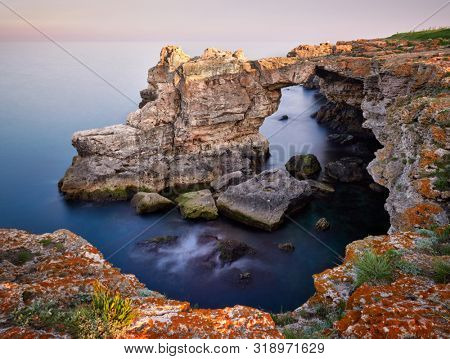 poster of gorgeous sea coast in summer dawn, the Black Sea - long exposure image
