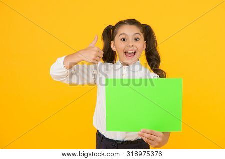 This Is Genius. Happy Girl Genius Holding Blank Paper Sheet On Yellow Background. Genius Child Givin