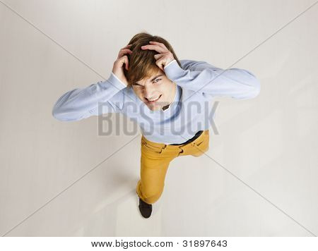 Funny portrait of a stressed young man