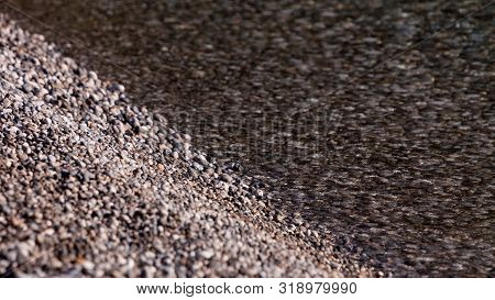 Many Tiny Rocks Pebbles Under Water Surface. Nature Details, Artsy Background Concept.