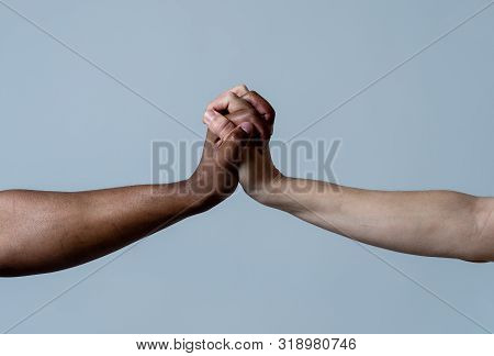Black African American And Caucasian Hands Holding Together Stop Racism. White And Black Skin Arms I