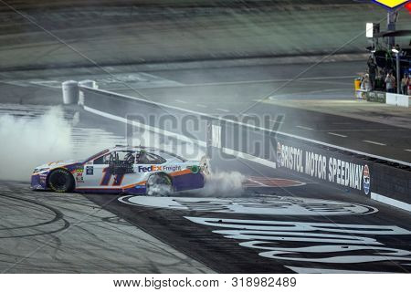 August 17, 2019 - Bristol, Tennessee, USA: Denny Hamlin (11) celebrates after he wins the Bass Pro Shops NRA Night Race at Bristol Motor Speedway in Bristol, Tennessee.