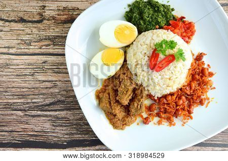 Indonesian Cuisine Nasi Padang, Rice With Beef Rendang, Salty Anchovy Peanut, Boiled Egg, Crushed Ca