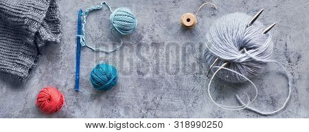 Various Wool Yarn And Knitting Needles, Creative Knitting Hobby Background, Panoramic Composition