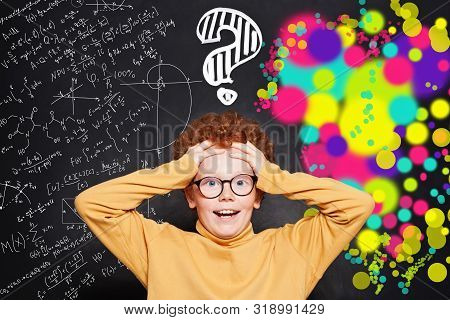 Kid With Question Marks On Background With Science And Arts Scetch