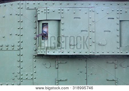 Texture Of Tank Side Wall, Made Of Metal And Reinforced With A Multitude Of Bolts And Rivets