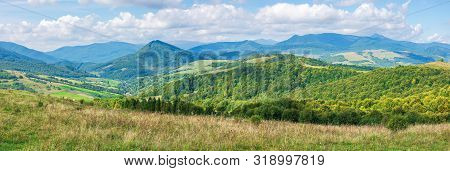 Panorama Of A Great Countryside Landscape. Beautiful Scenery In Mountainous Rural Area.  Agricultura