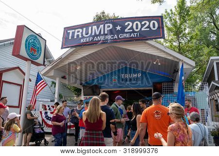 Falcon Heights, Mn - August 25, 2019: Fairgoers Gather Around The Trump Pence Mn Gop Vendor Booth In