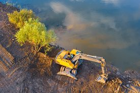 Aerial View Of A Excavator Ashore Quarry Near The Water