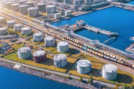 Aerial View Large Port Oil Loading Terminal With Large Storage Tanks. Railway Infrastructure For The