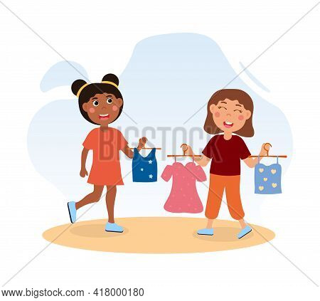 Happy Cute Little Girls Choose Clothes Together. Little Children Are Trying On Dress And Blouse In A