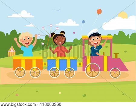 Happy Little Children Are Riding The Train Together. Smiling Excited Kids Enjoing Riding Colorful Tr