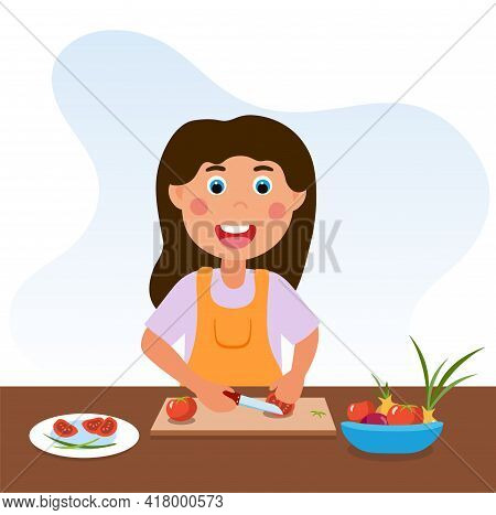Cute Happy Little Kid Is Cooking Vegetables. Smiling Little Girl Is Enjoing Cooking At Home To Help