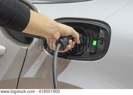 Close-up Asia Men Hands Who Are Fueling A New Vehicle Electrification Via Rechargeable Electricity M