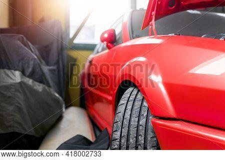 Close-up Detail View Wheel Of Custom Tuned Street Sportscar Racing Vehicle At Service Station Garage