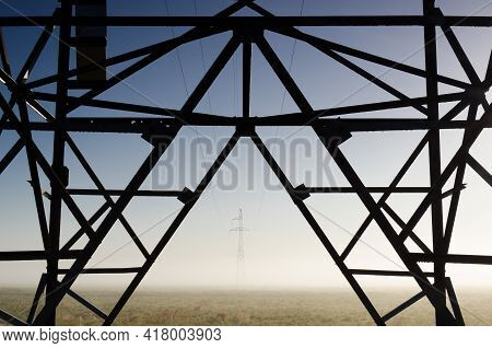 Power Engineering - High-voltage Line Fastened On A Great Tower Truss