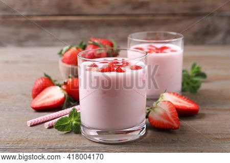 Yummy Drink With Strawberries On Wooden Table