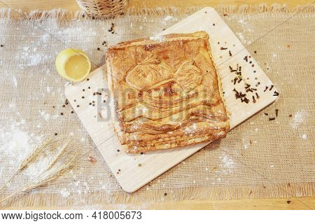 Pie, Lime And Pepper On A Chopping Board. The Food Is Ready To Eat. Puff Pastry Pastry