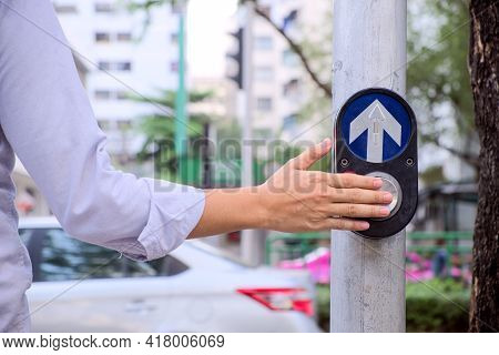 Back View And Close-up Hands Of Young Businessman Who Push Pedestrian Crossing Button And Wait A Gre