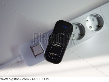 Network Adapter For Charging Your Smartphone. 220 Volt Adapter For Fast Charging Of Gadgets.