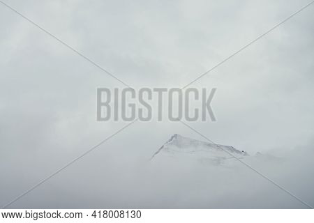 Minimal Mountain Landscape With High Pointy Rock In Clouds. Minimalist Mountain Scenery With Sharp S