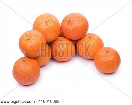 Heap of ripe tangerines on a white background. Tangerines isolated close up.