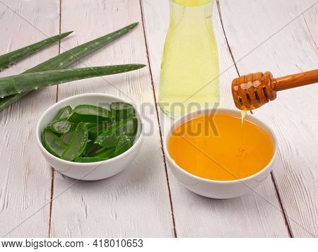 Aloe Vera And Honey Closeup On Light Wooden Background. Sliced Aloe Vera Natural Organic Renewal Cos