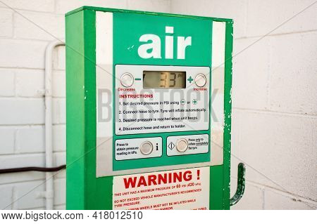 Air Service For Vehicle Tires. Automatic Inflator With Pressure Level Indicator On 33 Psi At Gas Sta