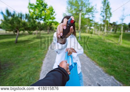 Woman Using Pepper Spray Or Tear Gas For Self Defence. Woman Defending Herself Against Thief In The