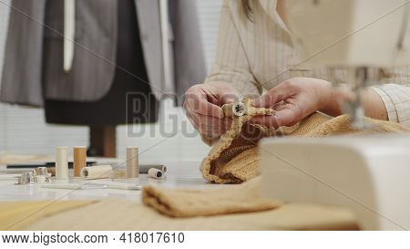 Hands Woman Dressmaker Working In Workshop With Tailoring Mannequin, Choose The Spool Thread For The