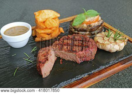 Mouthwatering Pink Brown Texture Of Cut Medium Well Grilled Filet Mignon Steak On Hot Stone Plate