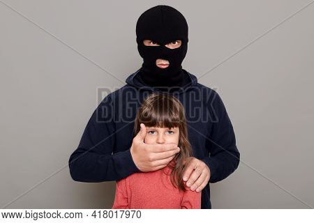Man Burglar In Balaclava Kidnapped Little Preschooler Girl, Holds Her Hostage, Covers Her Mouth With