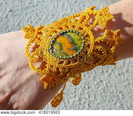 Yellow Bracelet Of Macrame With Stone Jasper On A Womans Hand