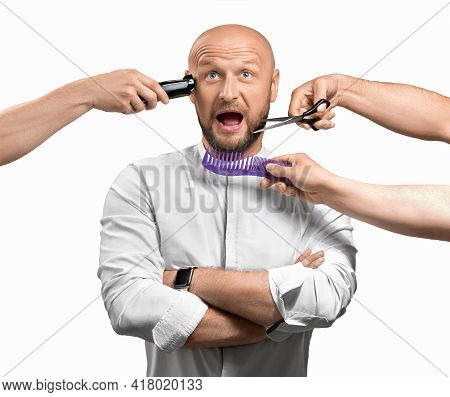 Bearded Man In A Hairdresser. Funny And Scared Man In A Hairdressing Salon, Hands Around Him With Ha