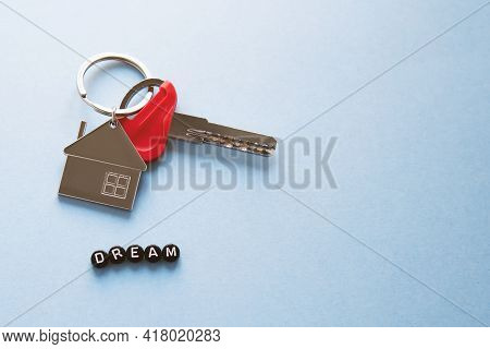Keychain In The Form Of A House With A Key To A New Apartment, An Inscription From Black Dream Cubes