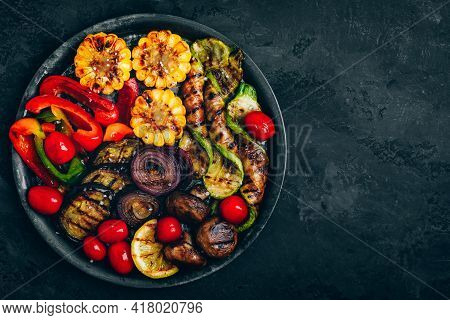 Grilled Vegetables In Bowl On Dark Stone Background, Top View.