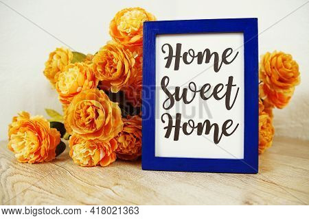 Home Sweet Home Text And Flower Bouquet On Wooden Table Interior Decoration