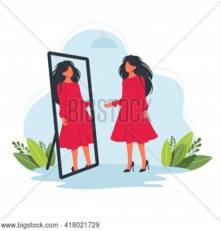 Woman Trying On A Beautiful Red Dress In The Store In Front Of The Mirror. Try On Fashion Clothes Co