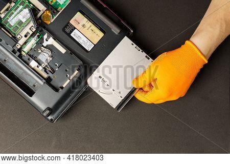 Novoukrainka, Ukraine - April 22, 2021: A Computer Repair Technician Disassembles A Laptop For Furth