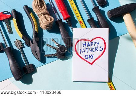 Happy Fathers Day Flat Lay. Blue Background With Tools, Give Dad A Present And A Card Heart With The