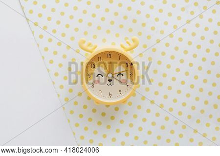 Bright Juicy Photo Of Children's Table Clock In The Form Of A Deer In Yellow Color On Yellow Polka D