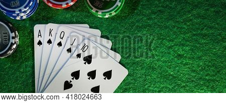 Royal Flush In Poker Game. Cards With Casino Chips On Green Cloth Table. Banner Copy Space