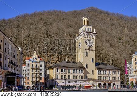 Sochi, Russia - March 4, 2020: Ski Resort Rosa Khutor. A View Of Town Hall With Clock On Rosa Square