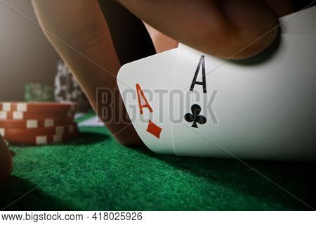 Peeking At Pocket Aces. Playing Poker In Casino With Ace Cards