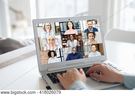 Group Of Diverse People Involved In Video Conference On The Laptop Screen. Female Using Computer App