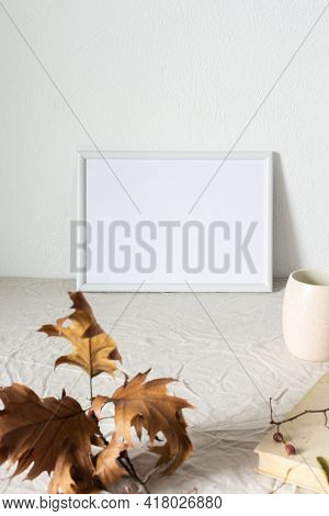 Home Decor Mocap, Empty Picture Frame Near White Painted Concrete Wall, Branches With Dry Leaves And